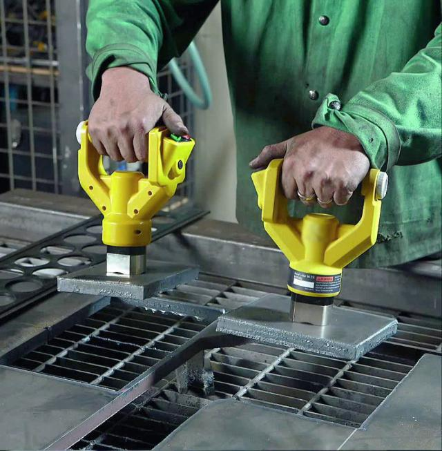 How can you transport small oily or sharp-edged workpieces?