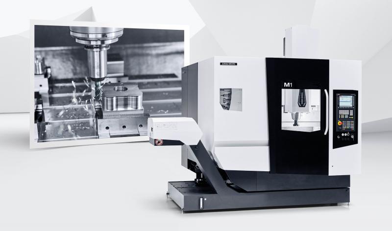 Weltpremiere M1: Auf lediglich 6 m² vereint die M1 einen stattlichen Arbeitsbereich von 550 × 550 × 510 mm und einen 850 × 650 mm großen Tisch für Werkstücke bis zu einem Gewicht von 600 kg.