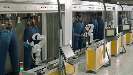 Proprietary robotics for garment finishing at AGI Denim.