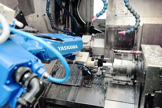 Robotic automation of a counter-spindle lathe