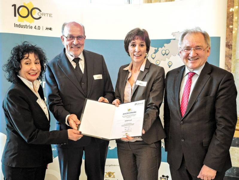 Happily and visibly proud the Rall family receives the award from Peter Hofelich. [From left to right: Hildegard Rall, Main Shareholder of Hainbuch, Gerhard Rall, CEO of Hainbuch, Sylvia Rall, Managing Director of Hainbuch, and Peter Hofelich, State Secretary in the Baden-Württemberg Ministry for finance and economy].