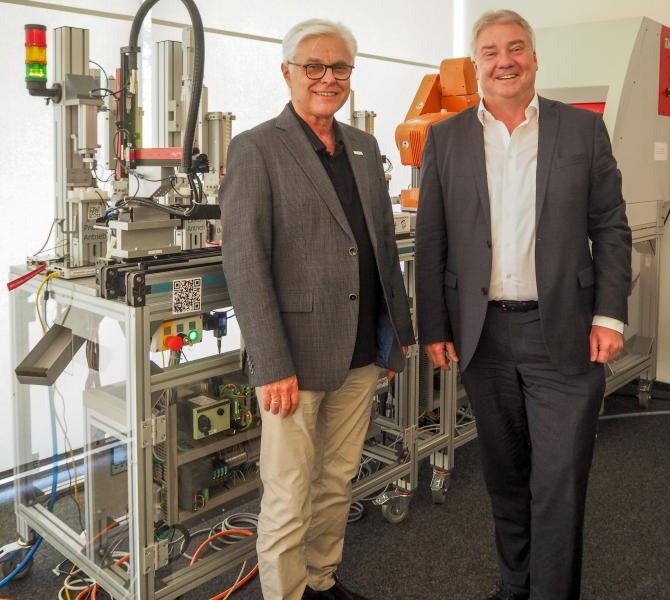 CodeMeter technology providing strong security for the key finder prototype production line at SmartFactoryKL presented by Prof. Dr. Detlef Zuehlke, CEO of Technologie-Initiative SmartFactory KL e.V. and Director of the Research Department Innovative Factory Systems at DFKI, and Oliver Winzenried, CEO and co-founder of Wibu-Systems.