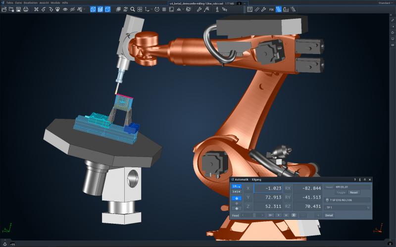 Ein 6-achsiger Roboter bearbeitet ein Bauteil auf einem synchron bewegten Rundtisch mit zwei zusätzlichen Achsen.