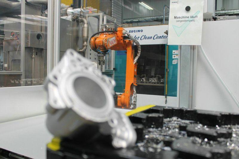 Automatisierte Anlage zum Hochdruckentgraten